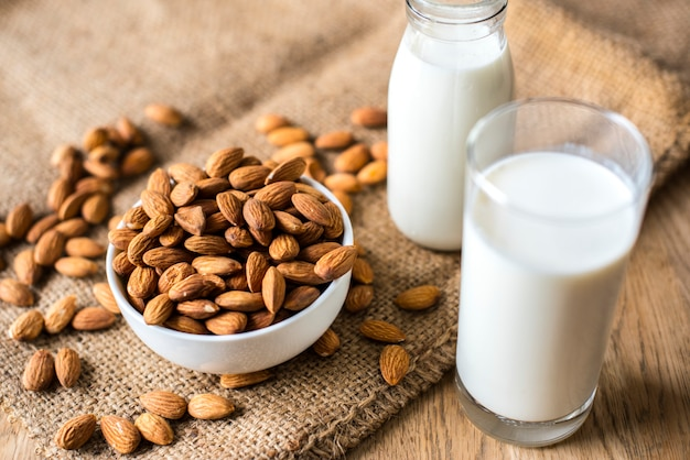 Organic almond milk and almonds Free Photo