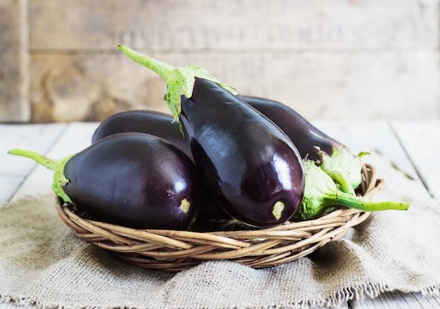 Organic eggplants in basket Premium Photo