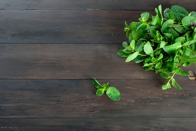 Organic fresh sprigs of mint on the wooden table Premium Photo