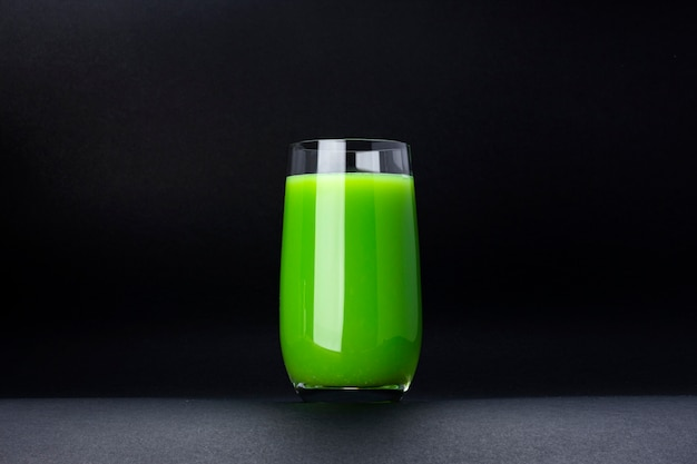 Organic green smoothie, apple juice on isolated on black background with copy space, fresh cocktail Premium Photo