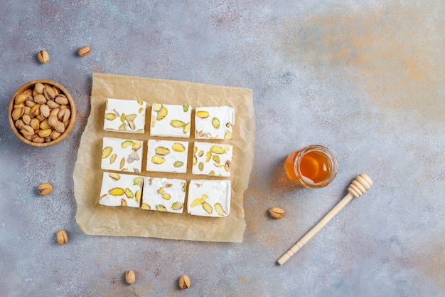 Organic homemade nougat made with honey, pistachio,top view Premium Photo