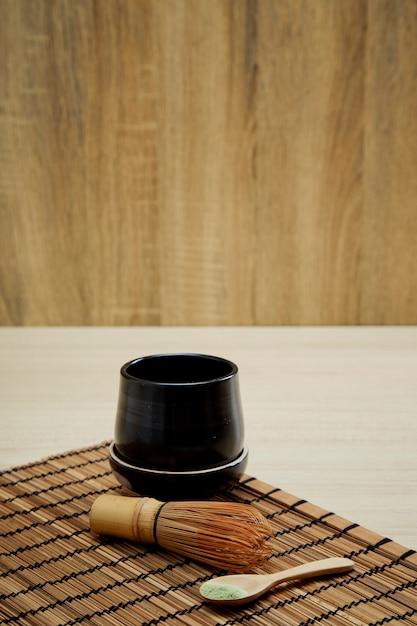 Organic matcha green tea on wooden Premium Photo