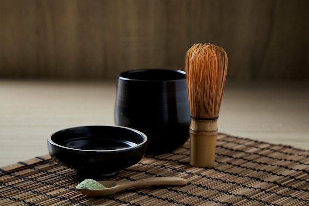 Organic matcha green tea on wooden Premium Photo