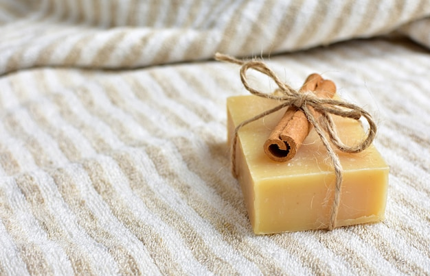 Organic, natural handmade soap with cinnamon on linen towel. Premium Photo