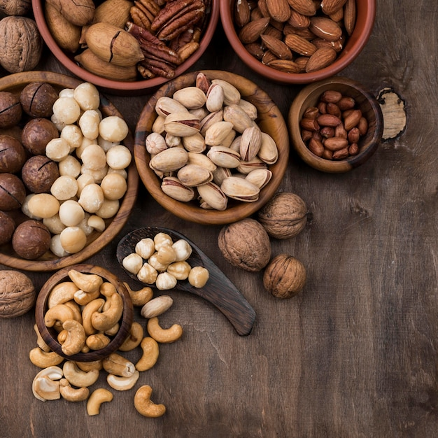 Organic nuts snack in bowls Free Photo