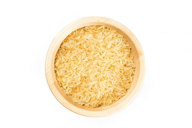 Organic rice on white. Premium Photo