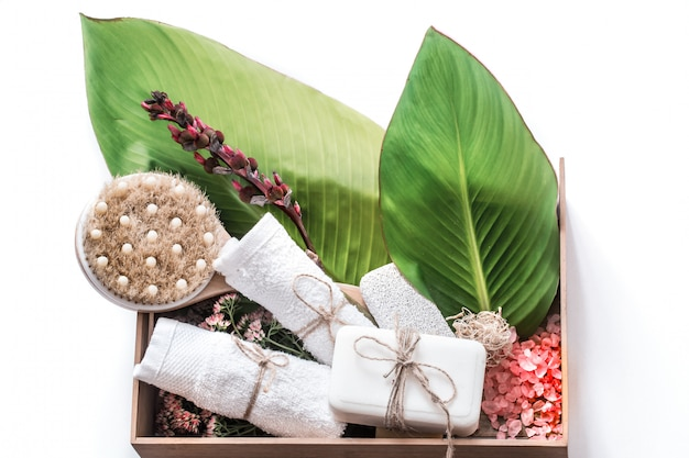 Organic spa products in a wooden box Free Photo