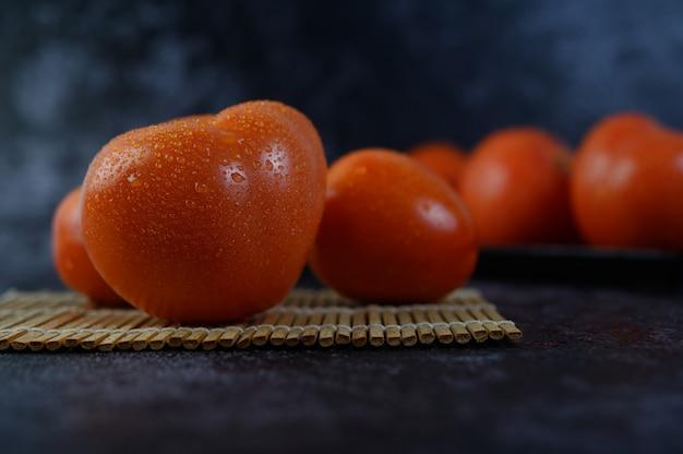 Organic tomato with water droplets in closeup macro. Free Photo