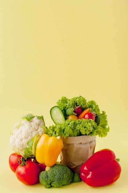 Organic vegetables on yellow background. Premium Photo