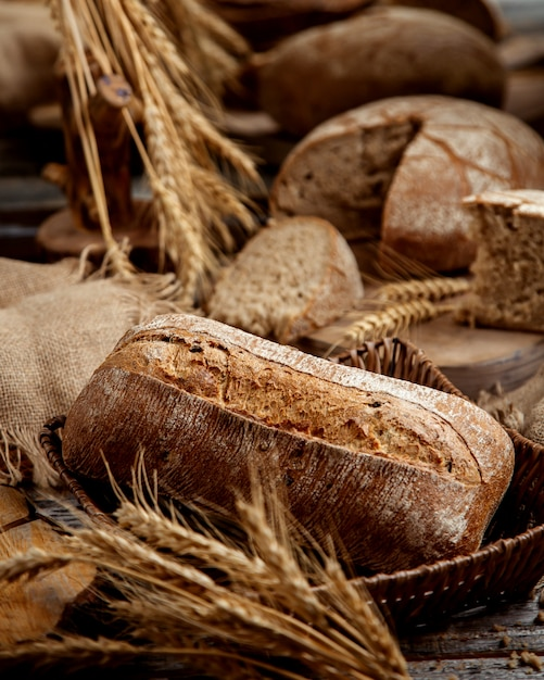 Organic whole grain bread decorated with grain ears Free Photo