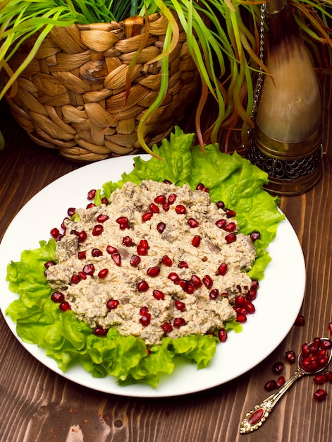 Oriental arabic, turkish food humus with pomegranate seeds. Free Photo