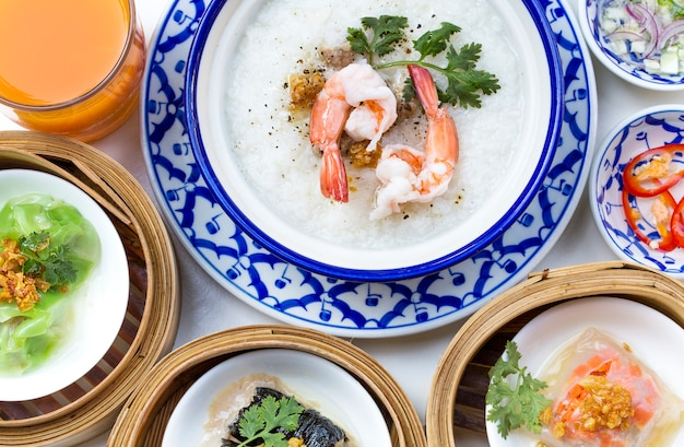 Oriental breakfast set with congee and dim sum set. Free Photo