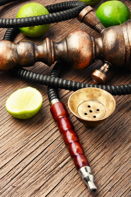 Oriental hookah shisha with lime Premium Photo