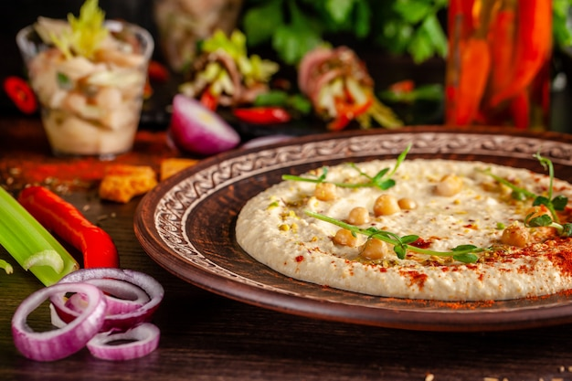 Oriental hummus with grilled sesame and pistachios. Premium Photo