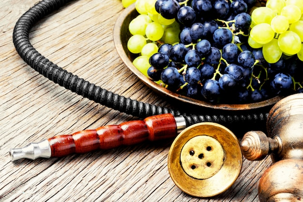 Oriental shisha with grapes Premium Photo