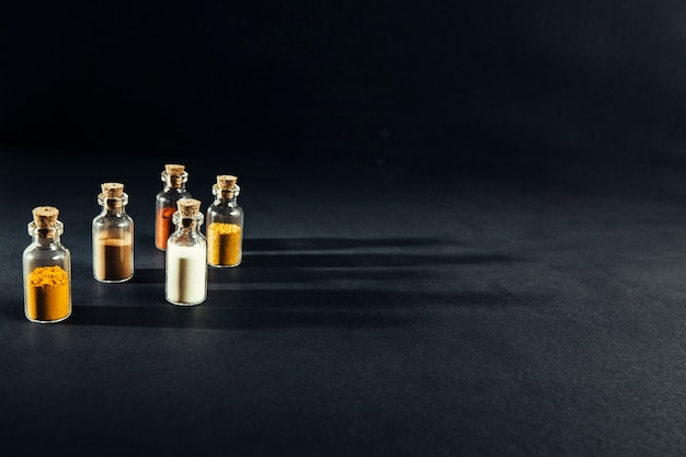 Oriental spices in small bottles Free Photo