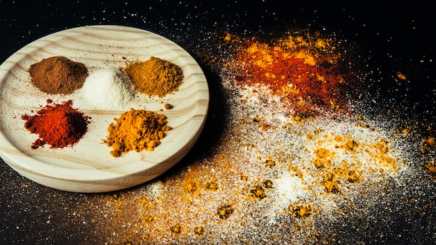 Oriental spices on wooden plate Free Photo