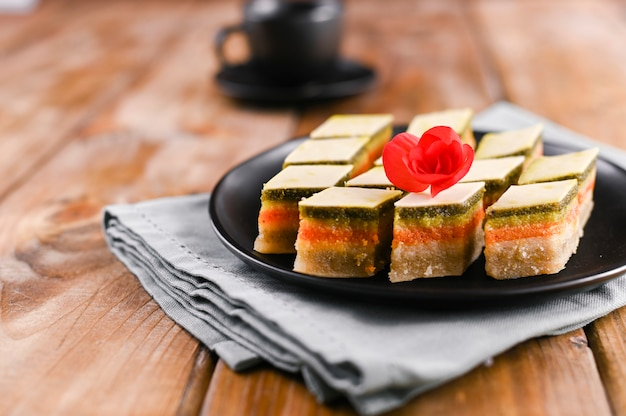 Oriental sweets with different tastes on a wooden background. traditional dessert and coffee. tasty national sweets. copy space. Premium Photo