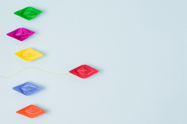 Origami boats leadership concept Free Photo