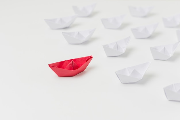 Origami boats representing leadership concept Free Photo