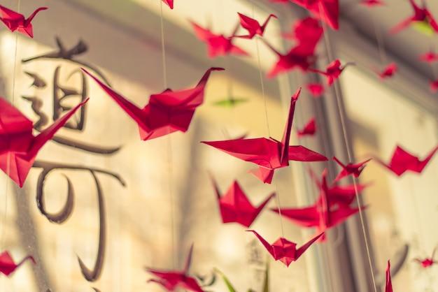 Origami cranes hangs on the ceiling Premium Photo