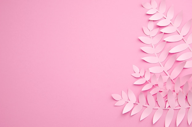 Origami exotic paper plants on pink background Free Photo