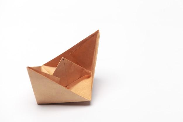 Origami paper boat isolated on white background Premium Photo