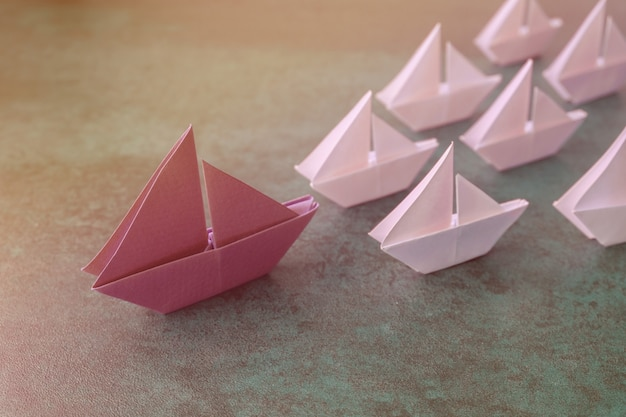 Origami paper sailboats, female woman leadership business concept Premium Photo
