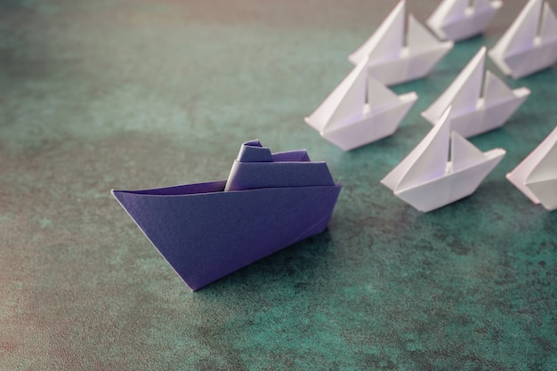 Origami paper ship with small sailboats Premium Photo