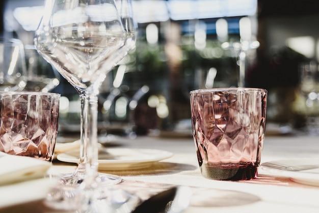 Original empty cutlery with elegant water glasses. Premium Photo