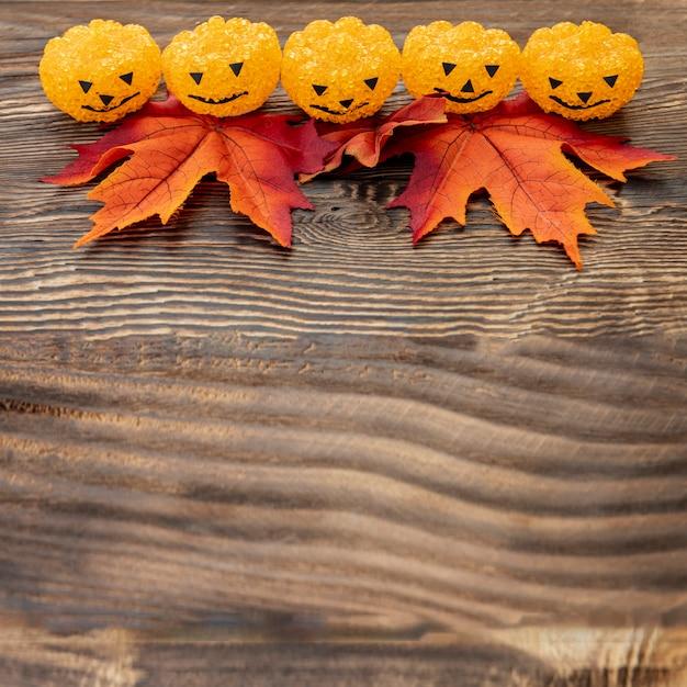 Ornamental halloween pumpkins on wooden table Free Photo