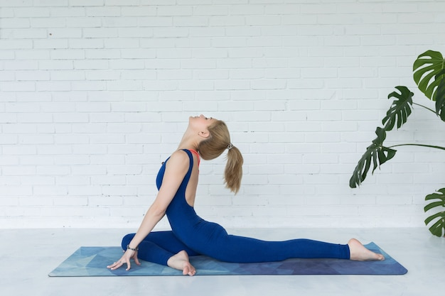 Oung woman meditates while practicing yoga Premium Photo
