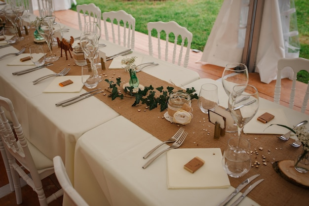 Outdoor catering dinner at the wedding with homemade garnishes decoration Premium Photo