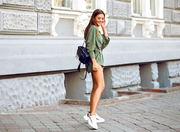 Outdoor fashion full length image of stylish woman walking on the street Free Photo