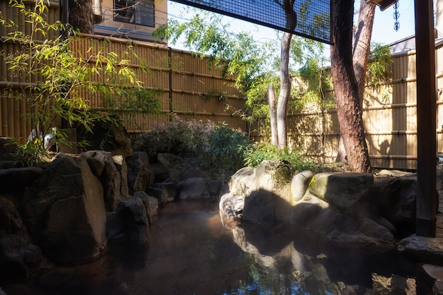 Outdoor hot springs or onsen in ryokan hotel Premium Photo