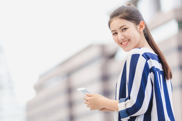 Outdoor lifestyle young businesswoman looking on smartphone. business concept Premium Photo