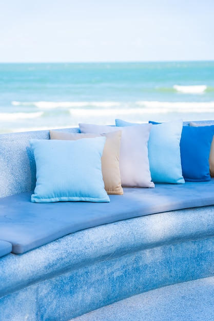 Outdoor patio in the beach with sofa and pillows Free Photo