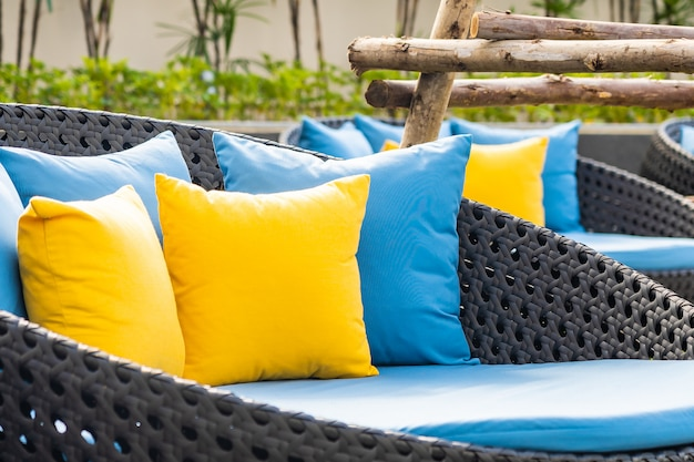 Outdoor patio in the garden with chairs and pillows Free Photo