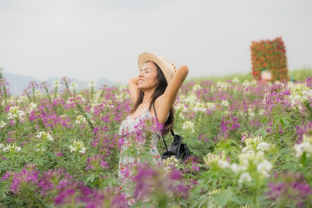 Outdoor portrait of a beautiful middle aged asia woman. attractive girl in a field with flowers Free Photo