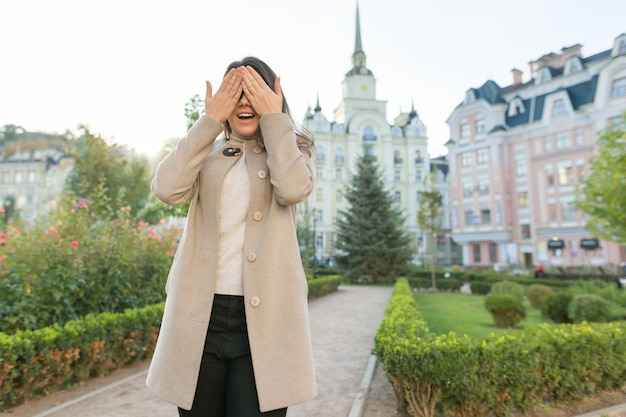 Outdoor portrait of young woman covering her eyes Premium Photo