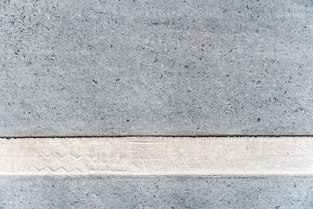 Outdoor road with white line marking on the bottom texture. Premium Photo