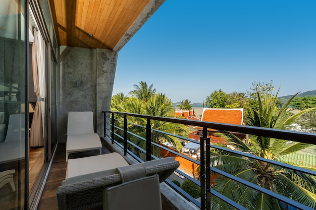 Outdoor seat on balcony with a view in pool villa, house, home, condo and apartment Premium Photo