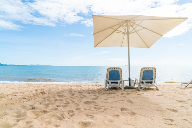 Outdoor with umbrella and chair on beautiful tropical beach and sea Free Photo