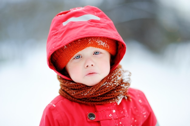 Outdoors portrait of sad crying little boy in winter. unhappy lonely child Premium Photo