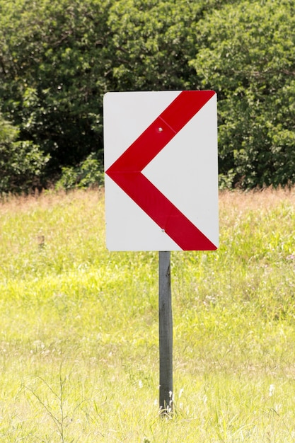 Outdoors road arrow sign pointing left Free Photo