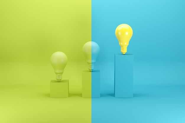 Outstanding bright yellow light bulb on the highest bar chart on green and blue Premium Photo