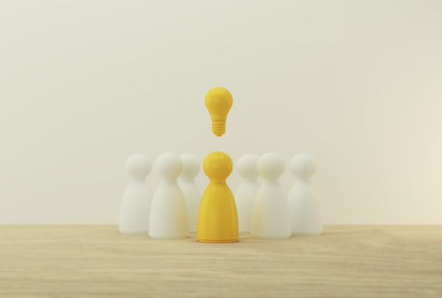 Outstanding yellow people standing with light bulb icon out from the crowd. human resource, talent management, recruitment employee, successful business team leader . Premium Photo