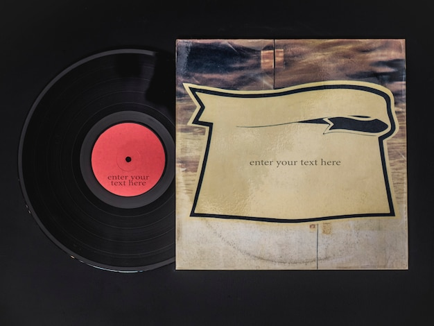 Overhead flat lay of vinyl record get out from the box  on black table Premium Photo