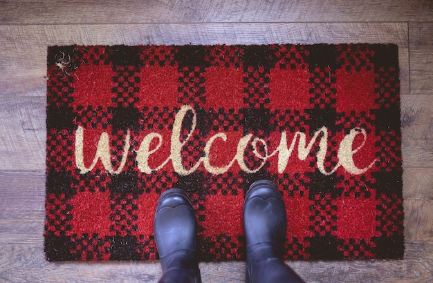 Overhead shot of a person standing on a welcome mat Free Photo