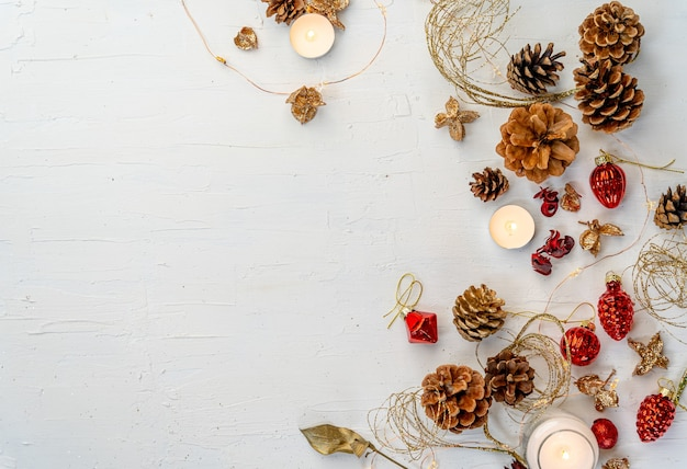 Overhead shot of a rustic colorful christmas decors on white wooden table with space for your text Free Photo